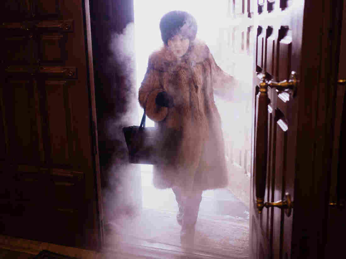"""A woman enters Preobrazhensky Cathedral in Yakutsk. """"You get this blast of freezing mist coming through the door,"""" photographer Amos Chapple says. """"It was just spectacular."""""""