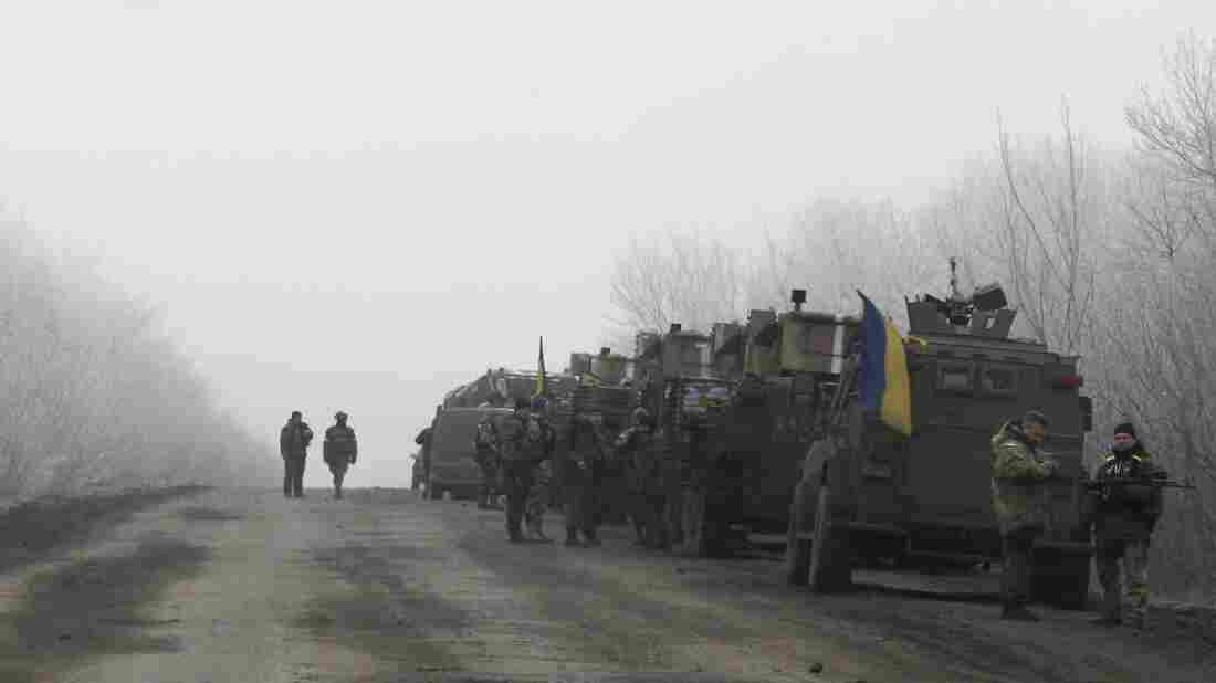 A Ukrainian military convoy stops on the road between the towns of Debaltseve and Artemivsk, Ukraine, on Saturday, hours before a cease-fire agreement is set to go into effect.