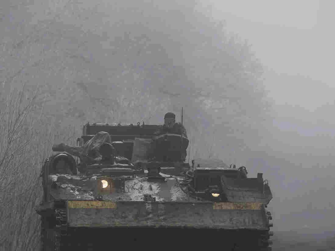 Members of the Ukrainian armed forces ride on a military vehicle not far from Debaltseve, eastern Ukraine on Sunday.