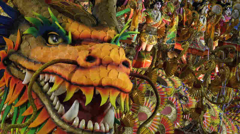 Performers from the Beija-Flor samba school parade on a float during Carnival celebrations at the Sambadrome in Rio de Janeiro on March 3, 2014. That year, the Beija-Flor parade was centered on a theme of communication throughout history; this year's theme, underwritten by Equatorial Guinea, is more controversial.