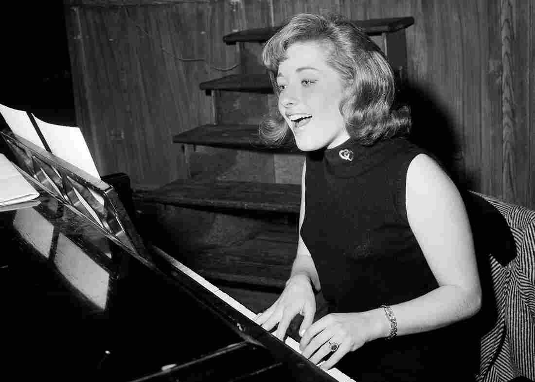 """Singer Lesley Gore rehearses at a piano, in New York in 1966. Gore topped the charts in 1963 with the epic song of teenage misery, """"It's My Party."""""""