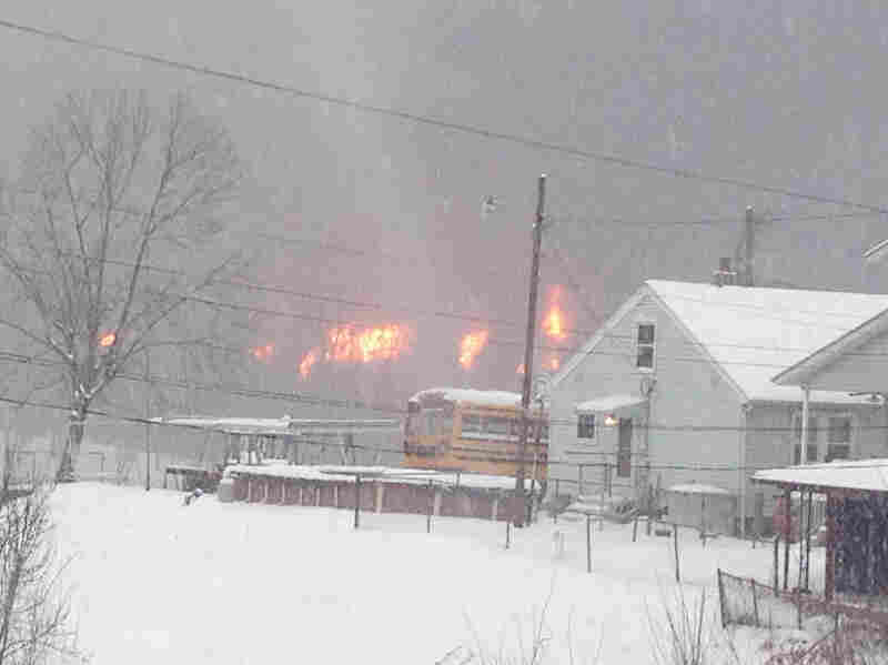 A fire burns Monday, after a train derailment near Charleston, W.Va. Nearby residents were told to evacuate as state emergency response and environmental officials headed to the scene.
