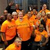 The Dallas Street Choir performed in T-shirts, then changed into formalwear for the Street Requiem. Baritone Russell Rodriguez is in front, far right, in an orange T-shirt.