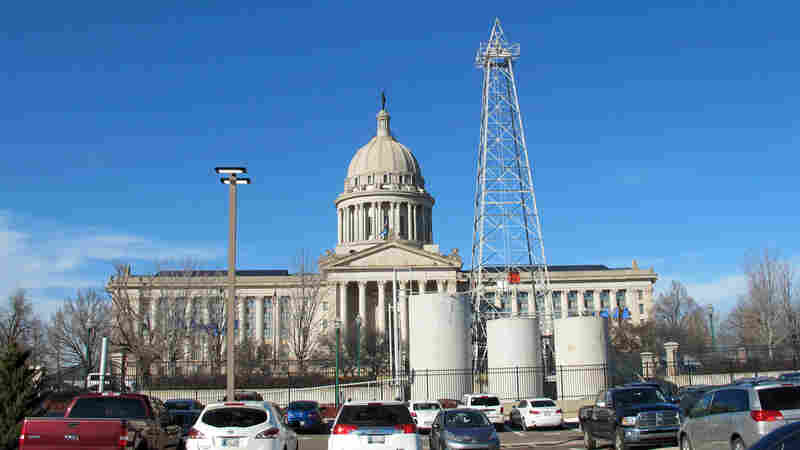 A functioning oil rig sits in front of the capital building in Oklahoma City, Okla. The oil industry is an important employer in the state, but officials are concerned a technique used to dispose of wastewater from oil extraction is behind a surge in earthquakes here.