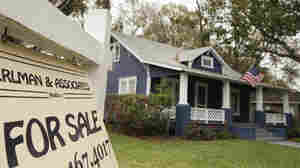 A realty sign hangs in front of a home for sale in Orlando, Fla. Housing advocates say banks, stung by the housing crisis and its fallout, remain reluctant to le