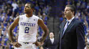 Kentucky's Aaron Harrison and coach John Calipari watch from the sideline during the second half of an NCAA college basketball game against Mississippi on Jan. 6. Kentucky won 89-86 in overtime.