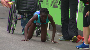 Reduced To Her Knees, Marathoner Finishes Race In A Crawl