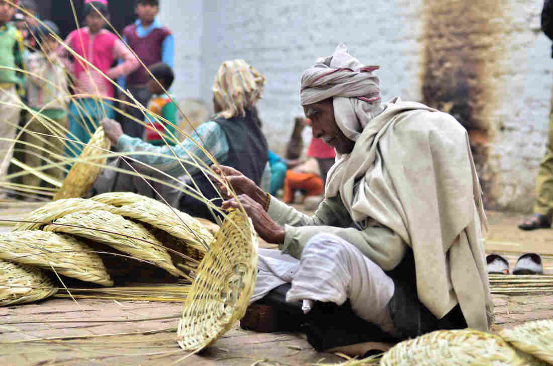 Baburam, 70, weaves baskets by hand — and seethes that after six decades of Indian independence, his village still has no power.