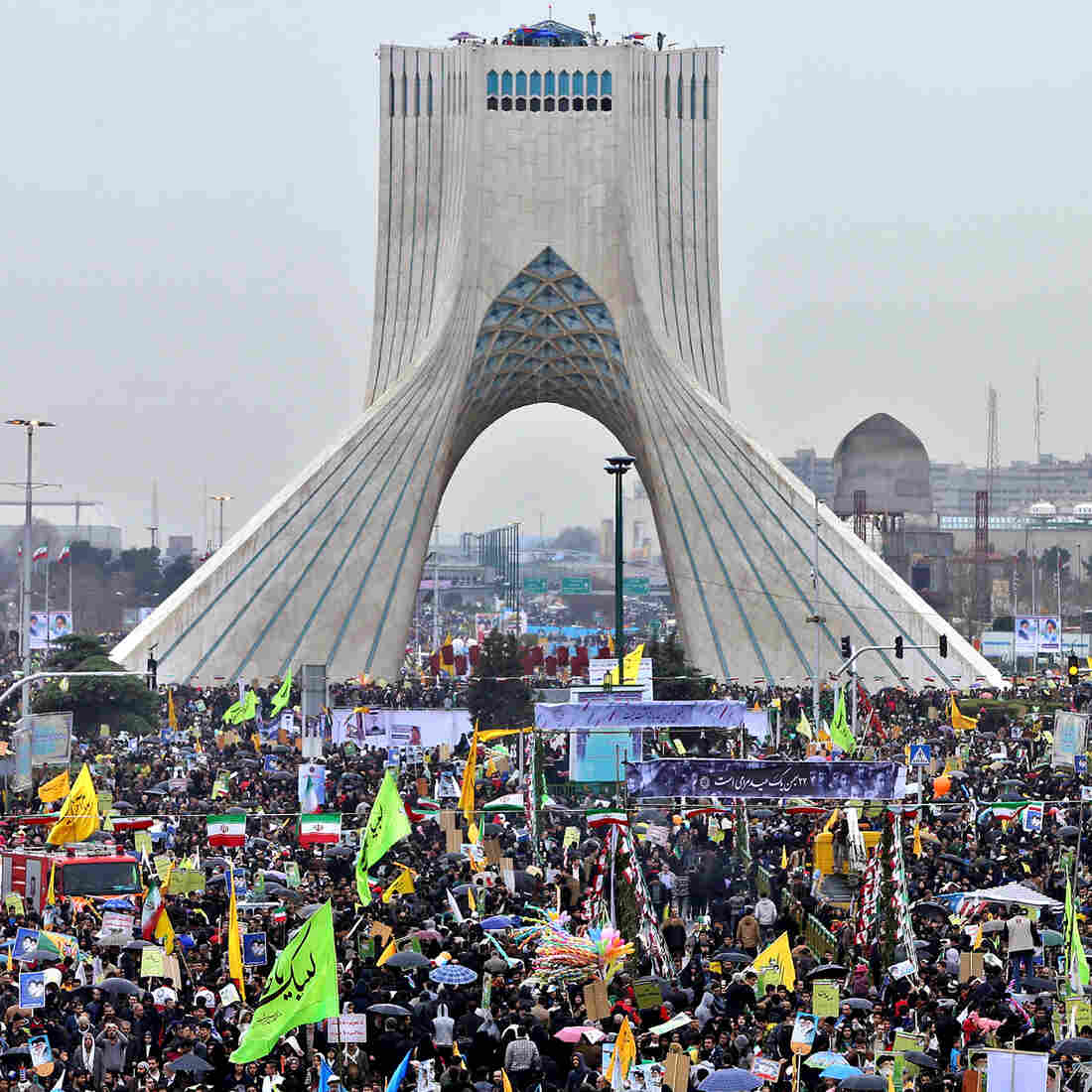 Iranians commemorate the 36th anniversary of the Islamic Revolution near the Azadi Tower in Tehran on Wednesday. While many Iranians would like to reorder relations with the West, there's also plenty of skepticism about whether it will actually happen.