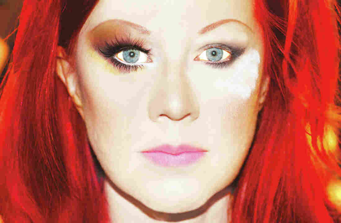 Kate Pierson's new album, her first as a solo artist, is titled Guitars And Microphones.