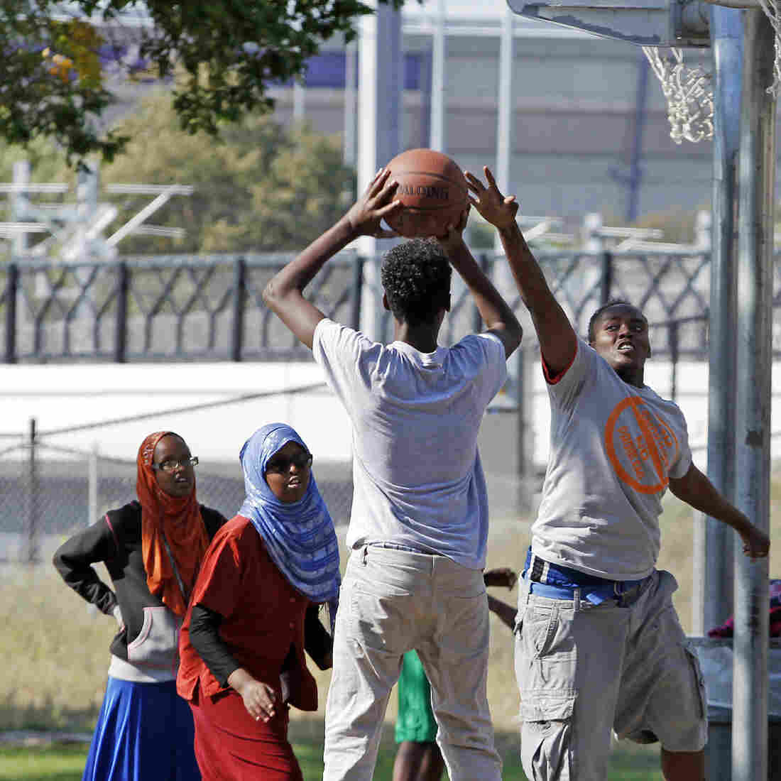 Somali-American youths play basketball before the start of a September 2013 solidarity rally by the Minneapolis Somali community to denounce al-Shabab's attack of a shopping mall in Nairobi, Kenya. Less than a decade after groups of teens from Minneapolis emigrated to Somalia to join the terrorist group, more have been recruited to join the self-declared Islamic State in Syria.