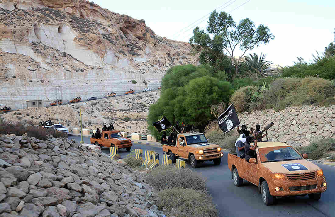 An armed motorcade belonging to members of Derna's Islamic Youth Council, which has pledged allegiance to the Islamic State, drives along a road in Derna, eastern Libya, in October 2014.