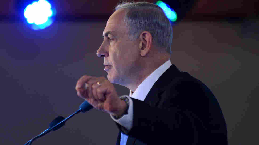 Israeli Prime Minister Benjamin Netanyahu, seen here speaking Monday, is under fire over a report of lavish spending.