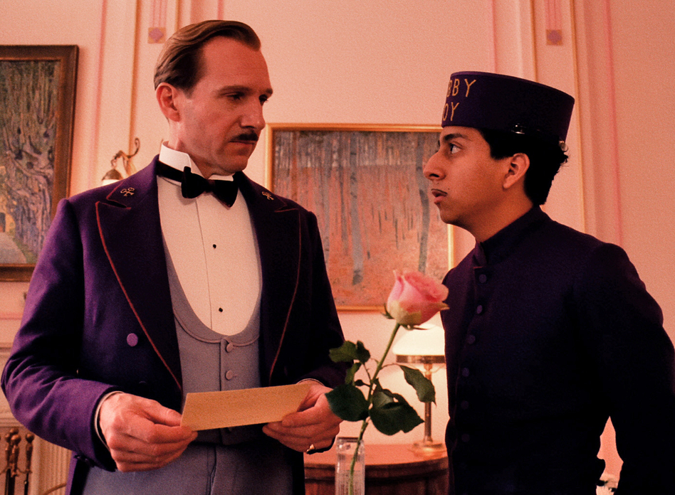 Ralph Fiennes and Tony Revolori as hotel concierge M. Gustave and his lobby-boy confidante, Zero, in <em>The Grand Budapest Hotel</em>.