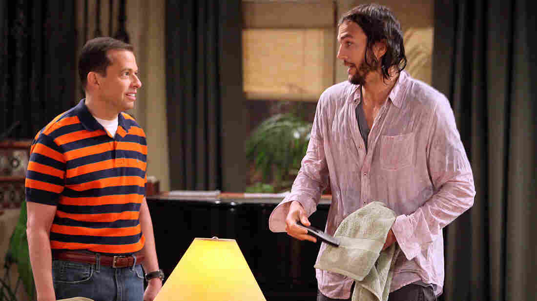 """Jon Cryer, left, and Ashton Kutcher in a scene from Kutcher's 2011 debut on CBS' """"Two and a Half Men."""""""