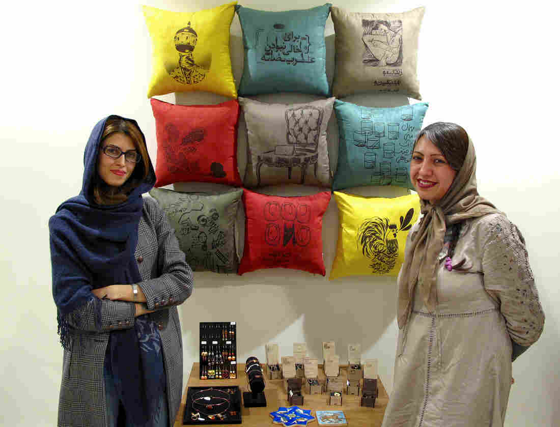 Sara Noghani (left) and Pooya Shahsiah, in their shop, Tehran Collage. Many of their designs feature words from Persian poetry that speak of a new dawn.