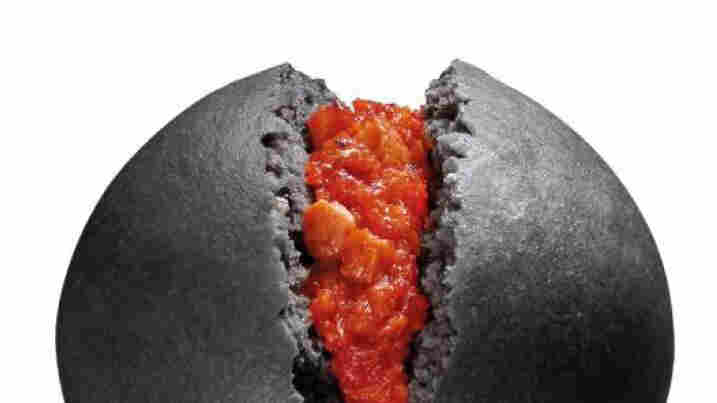 Like dragon eggs stuffed with fiery peppers: KISS steamed buns will hit convenience store shelve in Japan next week. The buns are seen here in a news release from the Circle K Sunkus chain.