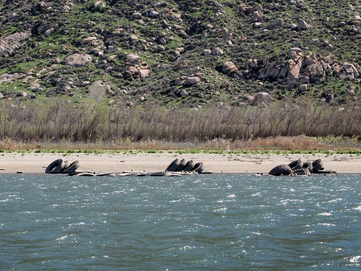 California 39 s drought exposes long hidden detritus npr for Lake perris fishing report