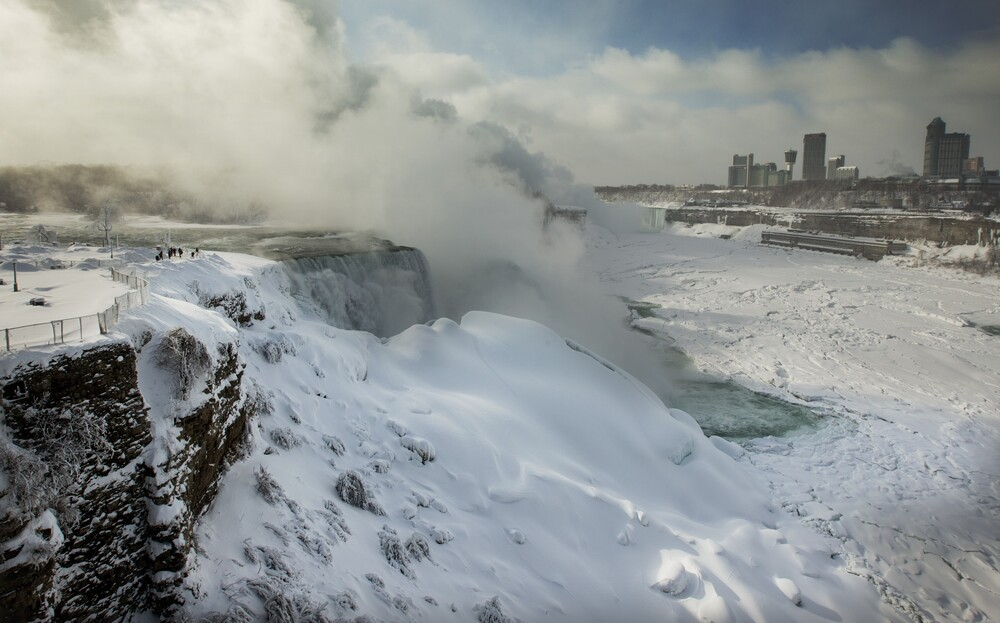 Tourists visit the frozen Niagara Falls on Thursday in Ontario, Canada. Niagara Falls has frozen over due to temperatures which dropped to 16F on Wednesday.