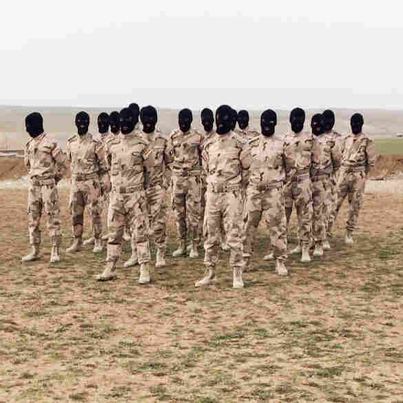 Training at a new camp near the front line, a mix of Arabs and Kurds prepare for an assault on Mosul in upcoming months. The men will wear balaclavas to conceal their identities while they fight, because they have family in Mosul and don't want to put their relatives at risk.