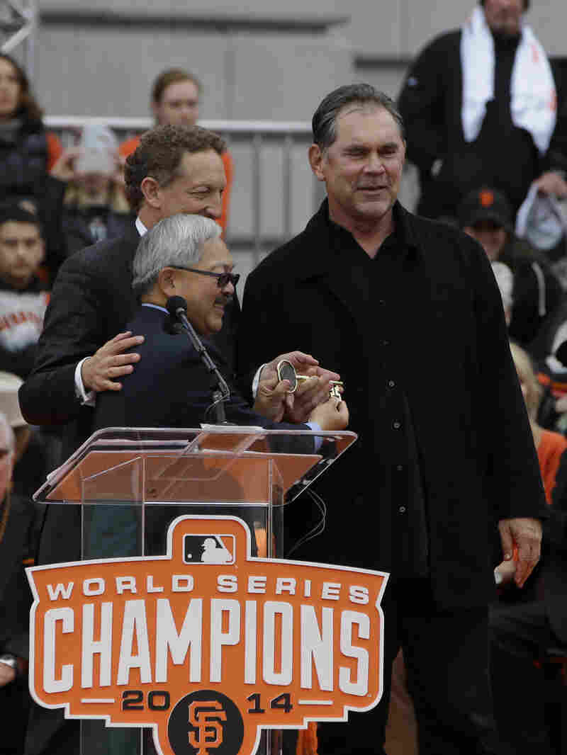 San Francisco Giants manager Bruce Bochy (right) had two heart stents inserted Thursday. He's seen here during the Giants' World Series victory parade last year.
