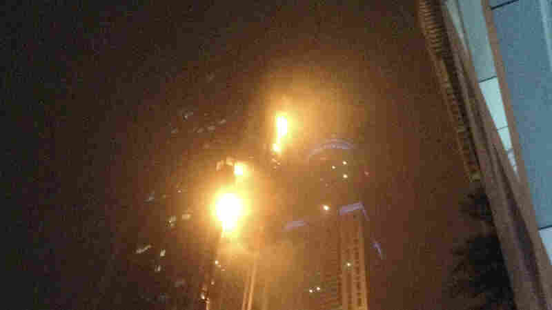 "A fire blazes at ""The Torch,"" a residential high-rise tower, in Dubai, on Saturday."