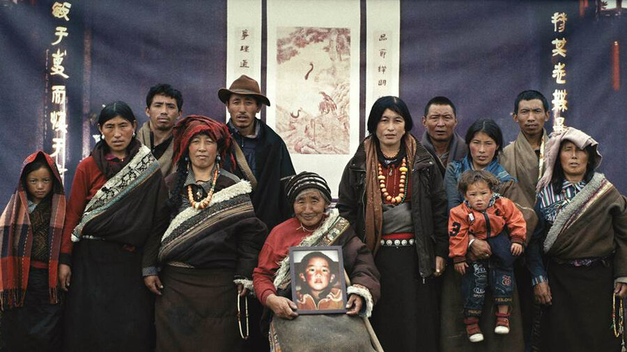 A family of Tibetan nomads — they're real, not actors — poses before an Asian backdrop in a new fictional short film.