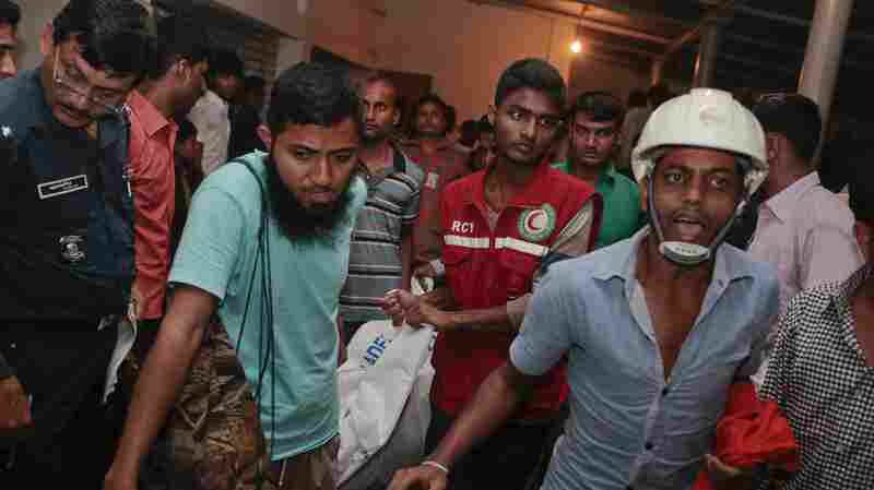 Bangladeshi rescue workers carry the dead body of one of the victims after a river ferry carrying about 100 passengers capsized Sunday.