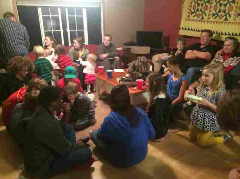 A dozen families gather in Dover, Del., for a house church meeting. Everyone brings something, either a dish for the potluck dinner or a conversation topic for the informal worship service.