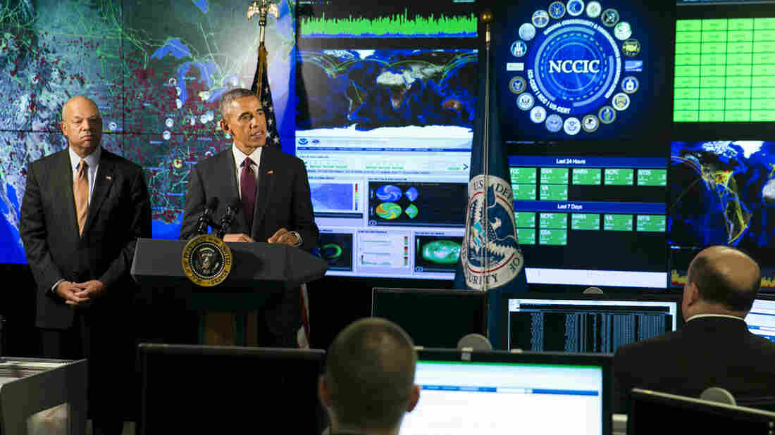 President Obama, joined by Homeland Security Secretary Jeh Johnson (left), delivers remarks at the National Cybersecurity and Communications Integration Center on Jan. 13 in Arlington, Va. Obama discussed efforts to improve the government's ability to collaborate with industry to combat cyber threats.