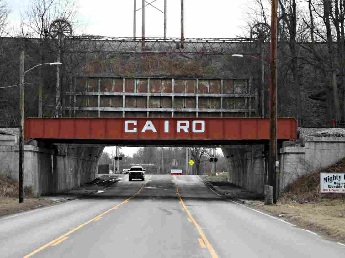 A big, metal gate designed in 1914 to protect Cairo, Ill., from flood waters marks the entrance to the town. Today, Cairo's population has dwindled to about 2,800 due in large part to floods, evacuations and a suffering economy.