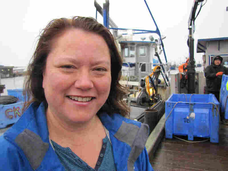 Quinault Indian Nation President Fawn Sharp stands on the docks as tribal crabbers unload their catch. The tribe has vowed to fight the oil train-to-ship terminals proposed for Grays Harbor.