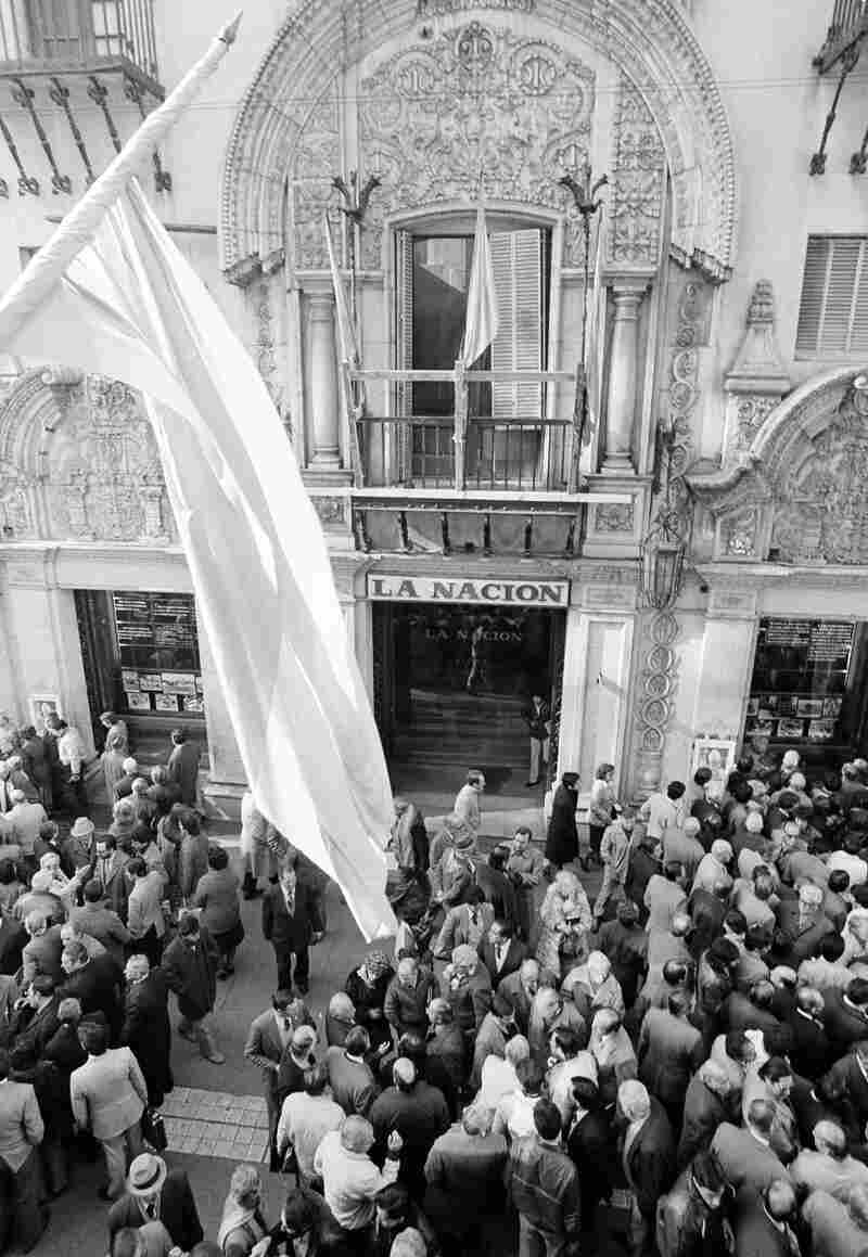 Argentines gather by the hundreds in Calle Florida in front of La Nacion newspaper offices in June 1982 to read the headlines and discuss developments in the war over the Falkland Islands after a cease-fire was announced. The decision led to chaotic protests in some parts of Argentina.