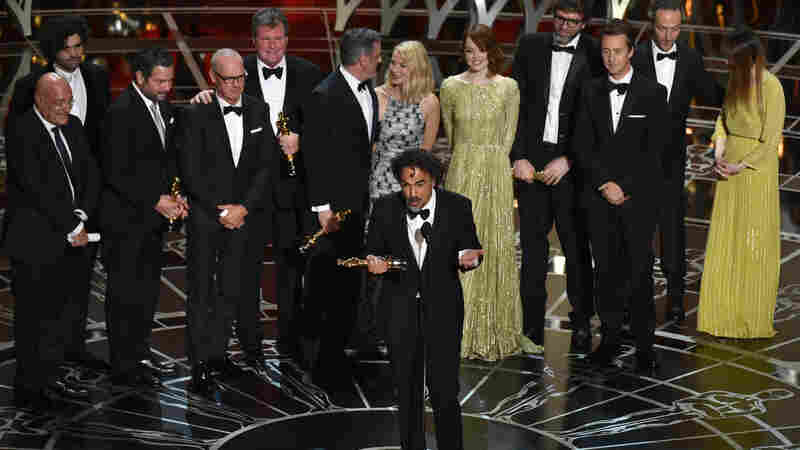 Alejandro Gonzalez Iñárittu (center) and the cast and crew of Birdman or (The Unexpected Virtue of Ignorance) accept the award for the best picture at the Academy Awards Sunday night in Los Angeles.