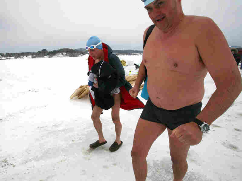 Silverio Bracaglia (left) and John Coningham-Rolls of London walk back to the warming hut after competing in the first U.S. Winter Swimming Championships at Lake Memphremagog in Newport, Vt.