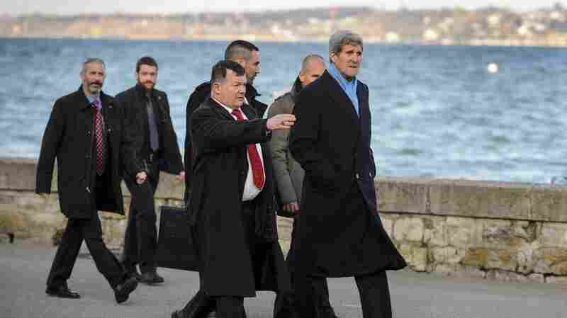 U.S. Secretary of State John Kerry goes for a stroll along the shore of Lake Geneva on Sunday prior to renewed nuclear negotiations in Geneva with his Iranian counterpart.