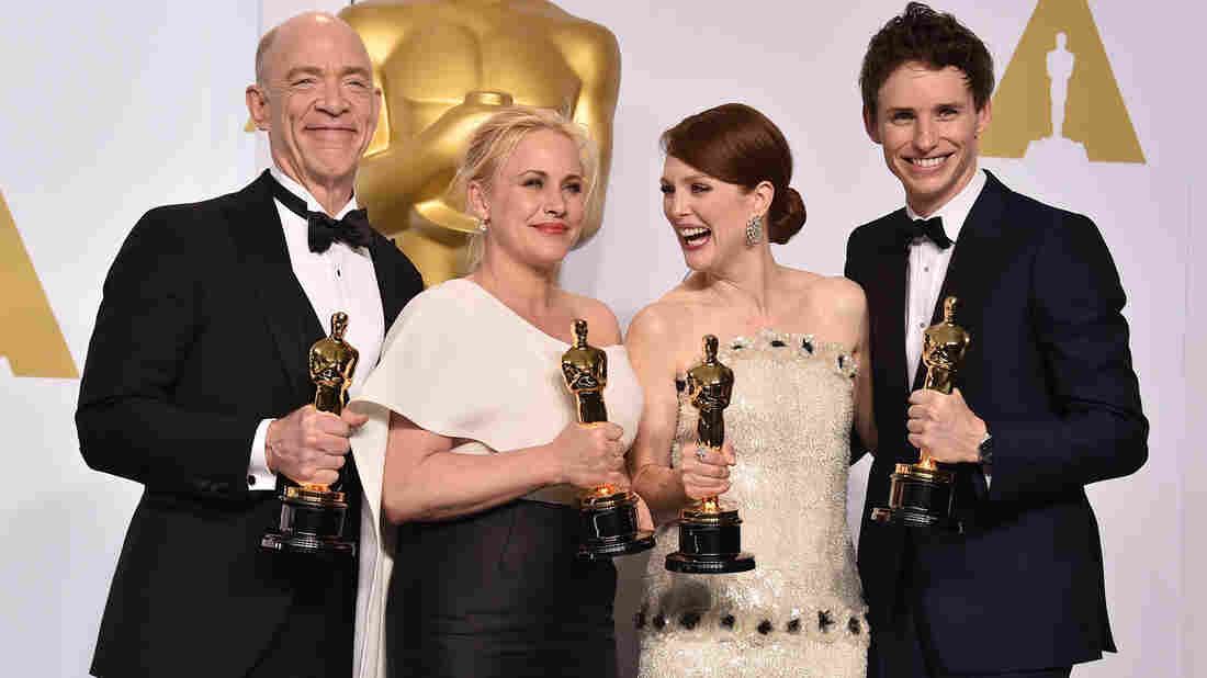 Oscar winners J.K. Simmons (best supporting actor), Patricia Arquette (best supporting actress), Julianne Moore (best actress), and Eddie Redmayne (best actor) pose with their trophies, after an awards show that was heavy on advocacy messages.