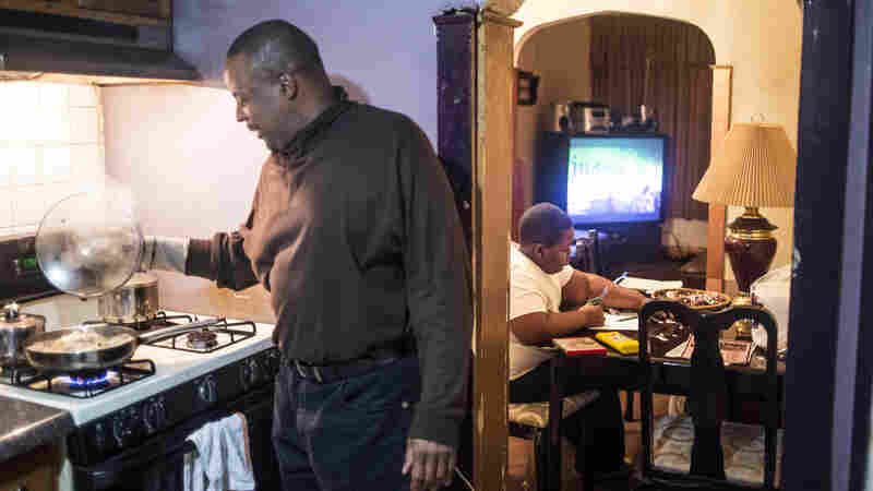 "Silvester Fullard fixes dinner for his 11-year-old son Tavestsiar. When Tavestsiar first came to live with his dad in 2010, he was closed off, Silvester says; ""he didn't want to be around other kids."""