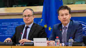 Jeroen Dijsselbloem, the head of the Eurogroup (right) sits next to Roberto Gualtieri, the chairman of the Committee on Economic and Monetary Affairs, during a meeting Tuesday at the European Parliament in Brussels. The European Union's executive branch said the list of Greek reform measures for final approval of the extended rescue loans is sufficiently comprehensive to be a valid starting point.
