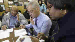 Chicago Mayor Rahm Emanuel (center and 8th Ward Alderwoman Michelle Harris join phone bank workers Tuesday on Election Day in Chicago. Emanuel was unable to clear the 50 percent threshold in the race, triggering a runoff election against a fellow Democrat in April.