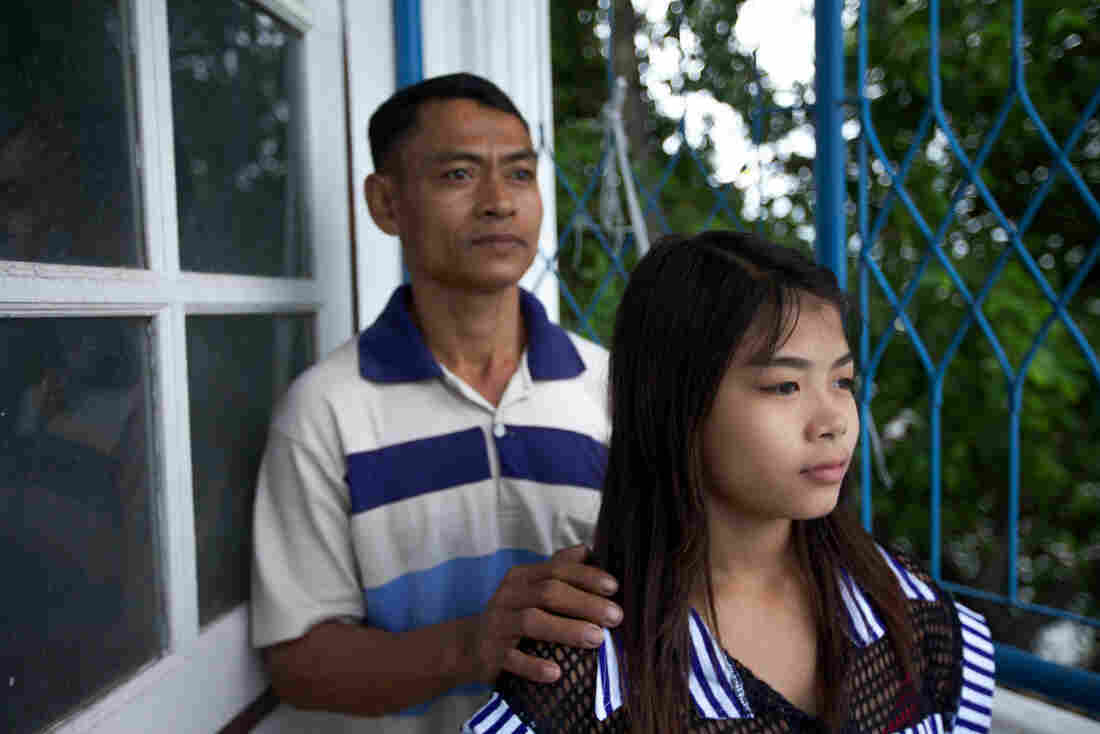 Burmese migrant Thazin Mon Htay and her father Ko Ngwe Htay were trafficked to Thailand to peel shrimp. They worked 16-hour shifts, seven days a week, for less than $10 a day, Ko Ngwe told PBS NewsHour.
