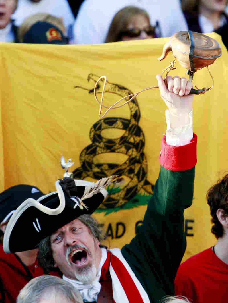 A man holds up a tea kettle during an Atlanta Tea Party tax protest in April 2009.
