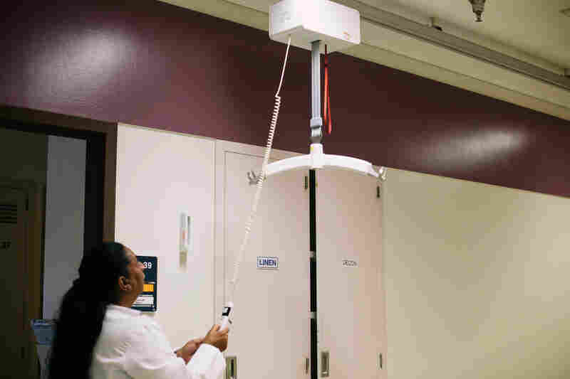 Tony Hilton, the safe patient handling and mobility coordinator at the VA hospital in Loma Linda, demonstrates one of the hospital's lifts.