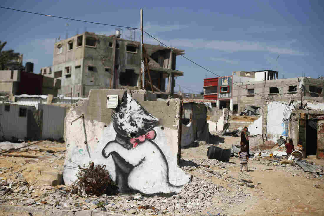A mural is seen on the remains of a house that witnesses said was destroyed by Israeli shelling during a 50-day war last summer in Beit Hanoun in the northern Gaza Strip.