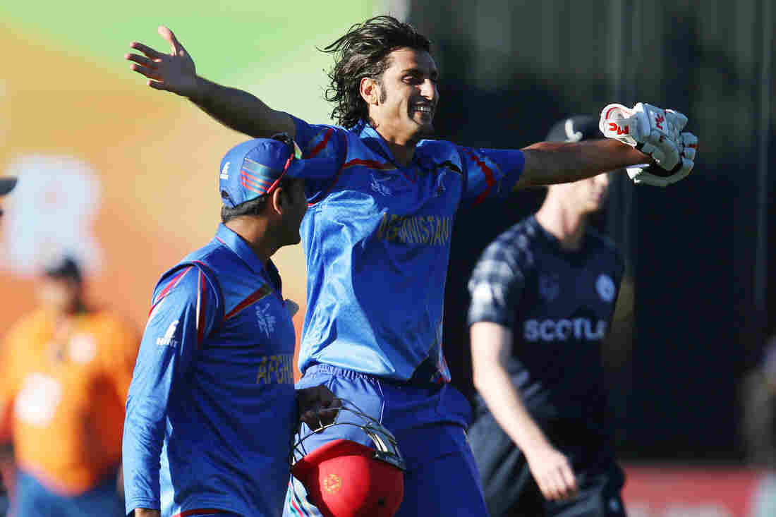 Afghanistan's Shapoor Zadran celebrates as he leaves the field after guiding his team to victory against Scotland in the Pool A game of the Cricket World Cup in Dunedin, New Zealand, on Thursday.