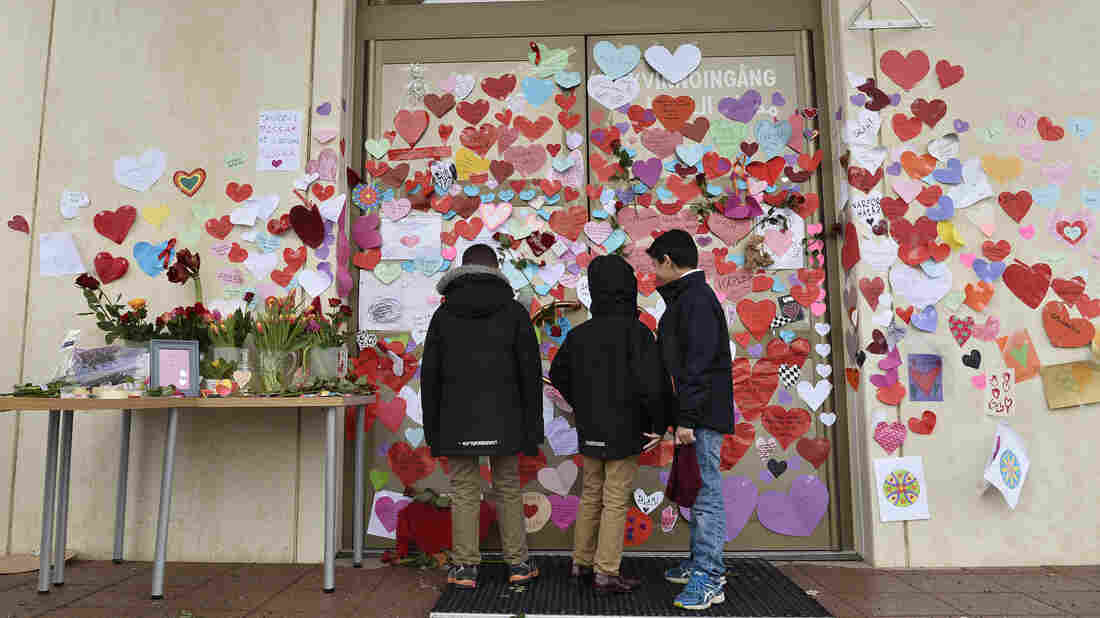 Boys in Uppsala, Sweden, read supportive messages placed at the entrance of a mosque following an attack in January. A new Pew study finds that religious intolerance is a global problem, with Muslims facing more hostility from individuals, and Christians from governments. Targeting of Jews, the study found, has gotten worse over in recent years.