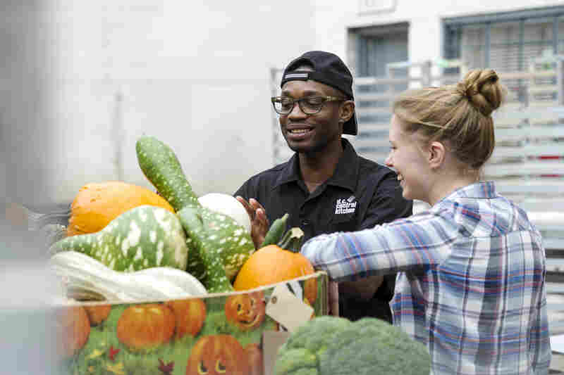 Student volunteers with The Campus Kitchens Project evaluate produce. The initiative gets high-school and college students to scavenge food from cafeterias, grocery stores and farmers' markets, cook it and deliver it to organizations serving low-income people in their communities.