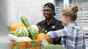 Student volunteers with The Campus Kitchens Project evaluate produce. The initiative gets high-school and college students to scavenge food from cafeterias, grocery stores and farmers' markets, cook it and deliver it to org