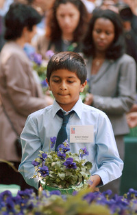 Robert Mathai was 8 years old when he lost his father, Joseph Mathai, a passenger on American Airlines Flight 11 when it crashed into the World Trade Center. In 2003, Robert, then 10, carried a pot of flowers to the site of a planned memorial in Boston. Today Mathai is a student at Tufts who recently traveled to Guantanamo Bay to witness court proceedings against the alleged Sept. 11 masterminds.
