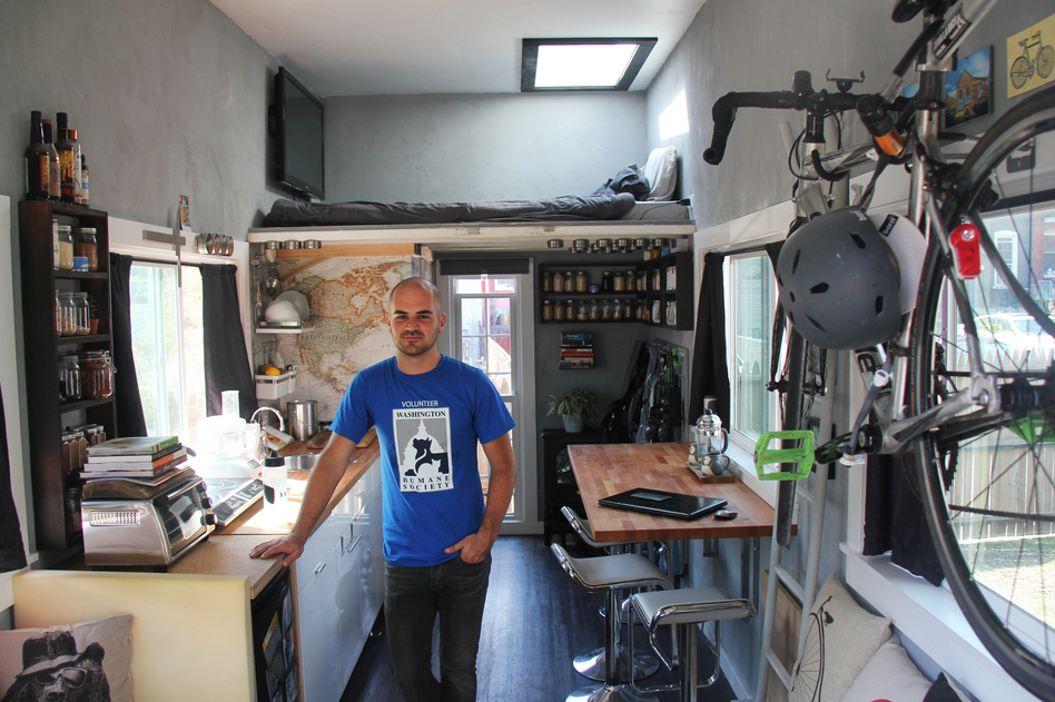 Jay Austin's tiny house in Washington, D.C., has 10-foot ceilings, a loft bed over the bathroom and a galley-style kitchen. (Franklyn Cater/NPR)